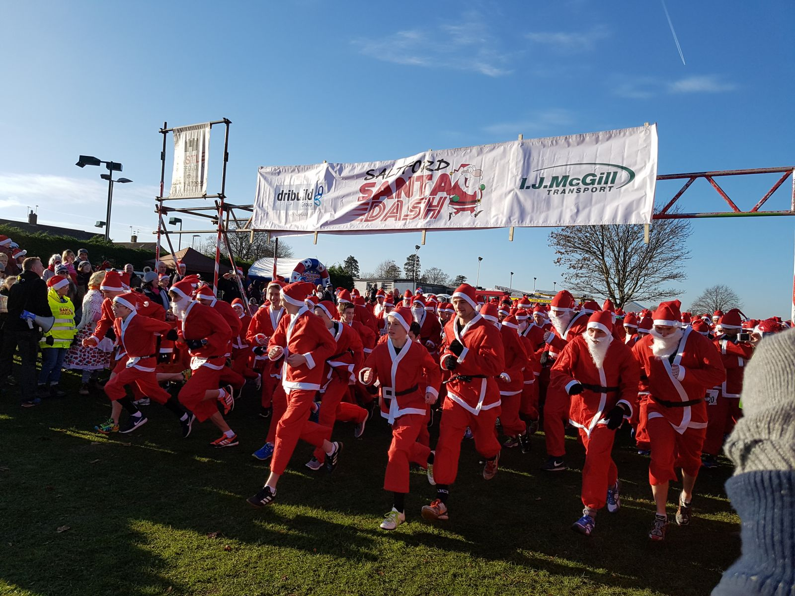 large goup of people all dressed as Santa Claus