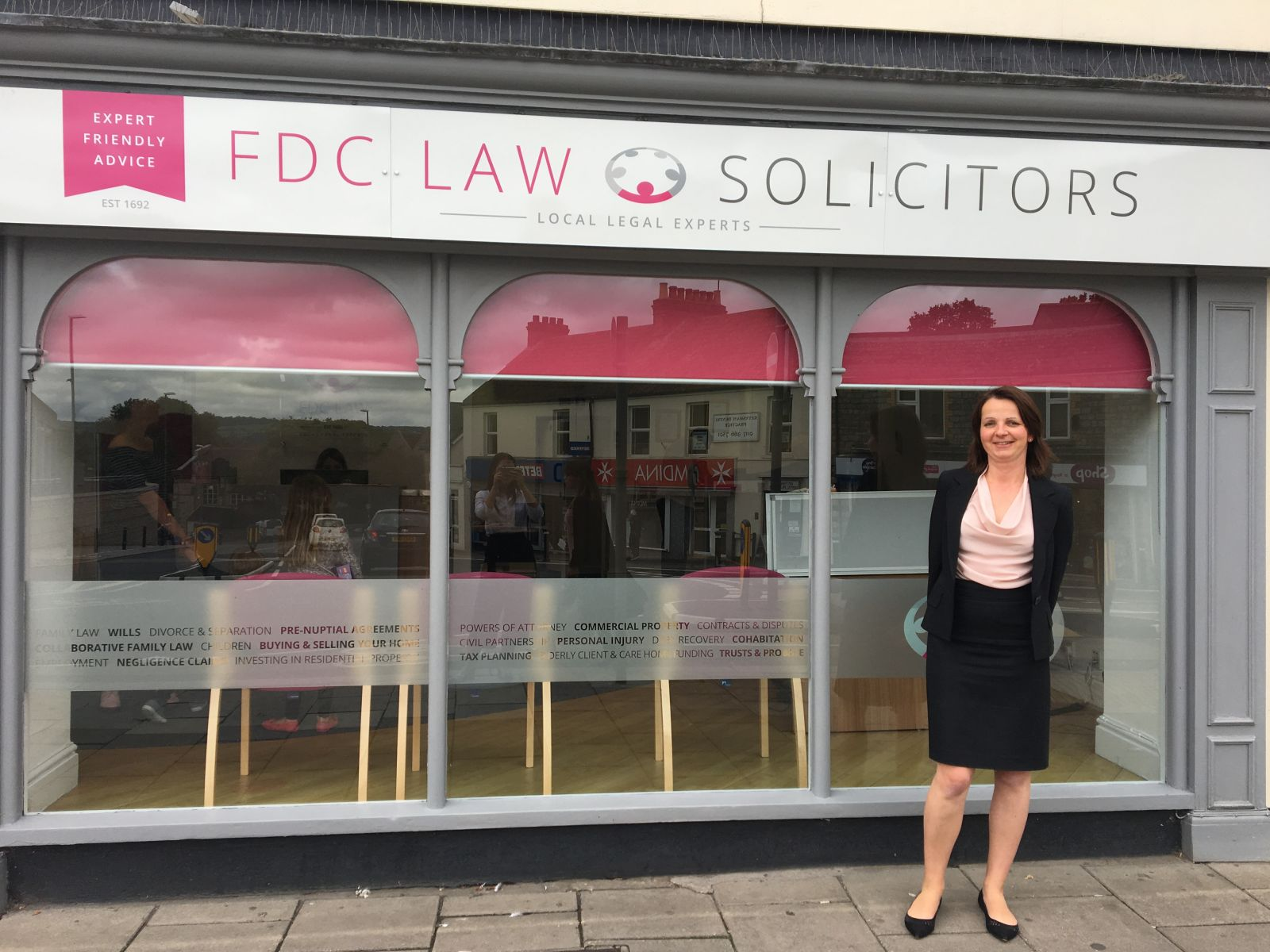 Agniezska Burfoot standing in front of FDC Law office windows